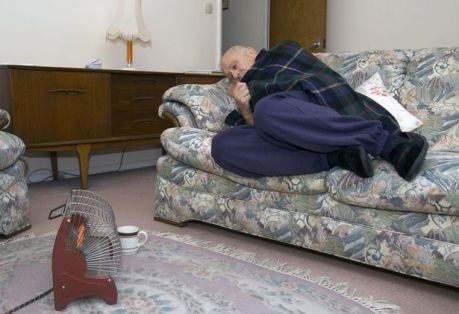 Elderly-man-who-can-only-afford-to-heat-himself-with-one-bar-of-the-electric-fire-UK